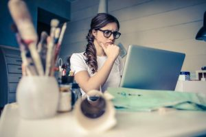 woman studying BAS paperwork