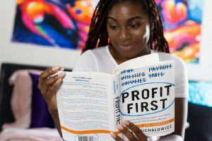 accountant reading book to on how to save money